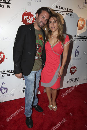 Stock Image of Actors Paulo Benedeti and Michelle Alexandria arrive to the Fear Net and Resident Evil Party at Voyeur Nightclub for Comic-Con weekend, in San Diego