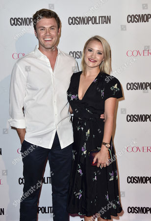 Blake Cooper Griffin, left, and Emily Osment arrive at Cosmopolitan magazine's 50th birthday celebration at Ysabel, in West Hollywood, Calif