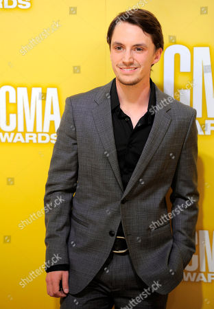 Stock Image of Greg Bates arrives at the 46th Annual Country Music Awards at the Bridgestone Arena, in Nashville, Tenn