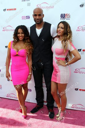 Fitness guru Rosa Acosta, actor Boris Kodjoe and designer Geebin Flores pose on the pink carpet at Darnaa's Listening Party and Live Performance Event on at Whisky a Go Go in West Hollywood, California
