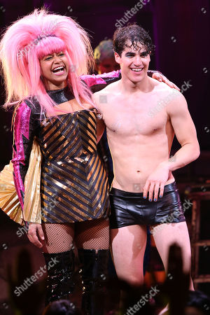 "Rebecca Naomi Jones, left, and Darren Criss appear on stage during the curtain call for his ""Hedwig and the Angry Inch"" debut performance at the Belasco Theatre, in New York"