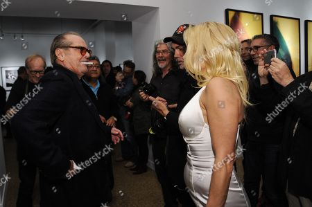 """Jack Nicholson, left, and Pamela Anderson attend David Bailey's """"It's Just a Shot Away: The Rolling Stones In Photographs"""" Opening Reception, in Los Angeles"""