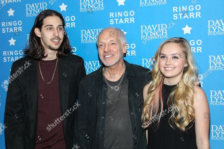 "Musician Peter Frampton with children Julian (L) and actress Mia Rose Frampton attend the David Lynch Foundation Honors Ringo Star ""A Lifetime of Peace & Love"" event held at the El Rey Theatre on in Los Angeles"