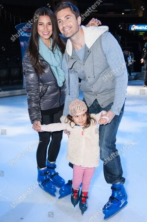Stock Photo of Roselyn Sanchez, Eric Winter, and daughter Sebella Rose Winter attend the Disney On Ice Presents Let's Celebrate!, in Los Angeles