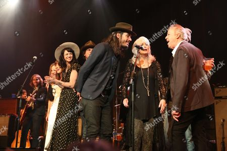 From left, artist Nikki Lane is all smiles as she and artists Cory Chisel, Emmylou Harris and Boz Scaggs perform at the Dylan Fest at Ryman Auditorium, in Nashville, Tenn