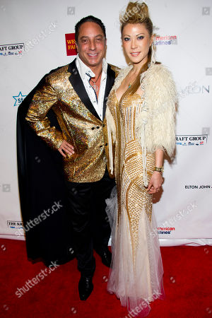 Stock Picture of Sir Ivan and Mina Otsuka attend Elton John's AIDS Foundation's 11th annual Enduring Vision benefit on in New York
