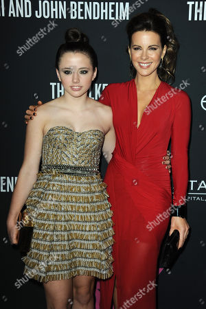 Lily Mo Sheen, left, and Kate Beckinsale arrive at Elyse Walkerâ?™s The Pink Party 2013 at Hangar 8 at the Santa Monica Airport on in Santa Monica, Calif
