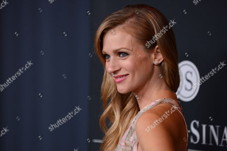 Actress AJ Cook arrives at Elyse Walkerâ?™s The Pink Party 2013 at Hangar 8 at the Santa Monica Airport on in Santa Monica, Calif