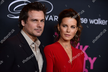 From left, Lily Mo Sheen, Kate Beckinsale and Len Wiseman arrive at Elyse Walker's The Pink Party 2013 at Hangar 8 at the Santa Monica Airport on in Santa Monica, Calif