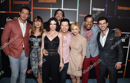 Sasha Roiz, and from left, Bree Turner, Bitsie Tulloch, Silas Weir Mitchell, Reggie Lee, Claire Coffee, Russell Hornsby and David Giuntoli arrive at Entertainment Weekly's Annual Comic-Con Closing Night Celebration at the Hard Rock Hotel, in San Diego