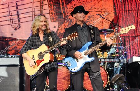 Musicians Tommy Shaw, left, and Chuck Panozzo from the band Styx perform at Eric Clapton's Crossroads Guitar Festival artist party at The Hard Rock Cafe New York on in New York