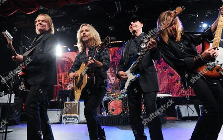 """From left, musicians James """"J.Y."""" Young, Tommy Shaw, Chuck Panozzo and Ricky Phillips of the band Styx, perform at Eric Clapton's Crossroads Guitar Festival artist party at The Hard Rock Cafe New York on in New York City, New York"""