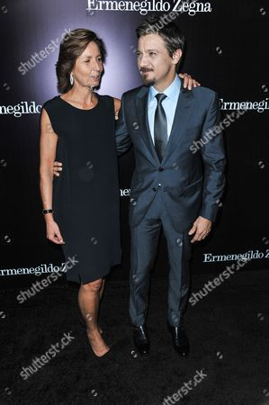 Anna Zegna, left, and Jeremy Renner arrive at the Ermenegildo Zegna Boutique opening on in Beverly Hills, Calif