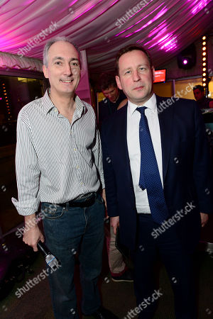 Stock Photo of Mike Weatherley MP and Ed Vaizey MP in the Terrace Bar as Fatboy Slim plays the House of Commons for Last Night A DJ Saved My Life Foundation. London