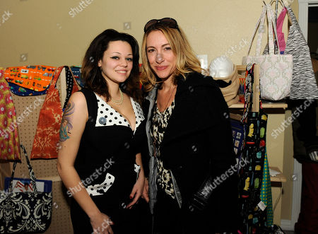 Actress Judi Beecher, right, visits the House of Minerva booth at the Fender Music lodge during the Sundance Film Festival, in Park City, Utah