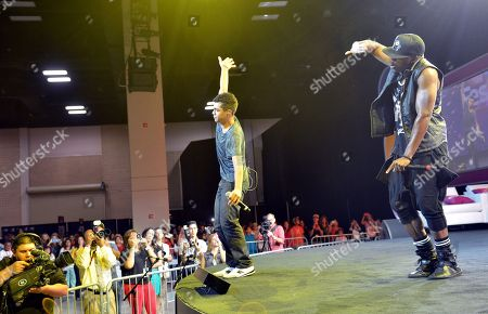 Singer/rapper Adam Irigoyen, left, performs onstage during Festival People en Espanol 2013, on at Henry B. Gonzalez Convention Center in San Antonio, Texas