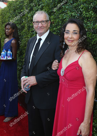 Ed O'Neill, left, and Catherine Rusoff arrives at the 67th Primetime Emmy Awards, at the Microsoft Theater in Los Angeles