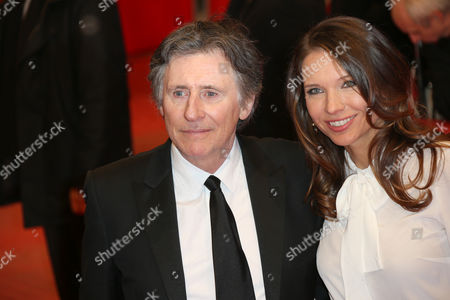 Irish actor Gabriel Byrne and Hannah Beth King pose for photographers upon arrival at the opening gala of the 2015 Berlinale Film Festival in Berlin