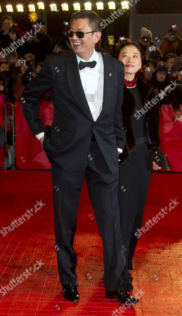 Stock Picture of Director Wong Kar Wai and wife Esther Wong arrive on the red carpet for the screening of the film The Grandmaster at the 63rd edition of the Berlinale, International Film Festival in Berlin, Thursday, Feb.7,2013
