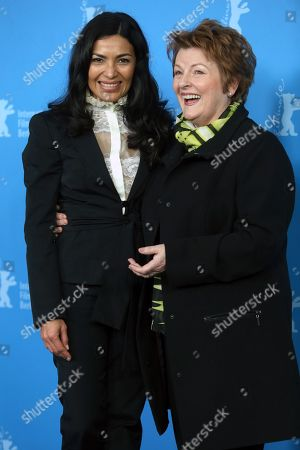 Mexican actress Dolores Heredia and English actress Brenda Blethyn pose for photographers at the photo call for the film Two Men in Town (La Voie de l'Ennemi) during the 64th Berlinale International Film Festival,, in Berlin