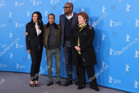 From left, Mexican actress Dolores Heredia, French director Rachid Bouchareb, American actor Forest Whitaker and English actress Brenda Blethyn pose for photographers at the photo call for the film Two Men in Town (La Voie de l'Ennemi) during the 64th Berlinale International Film Festival,, in Berlin