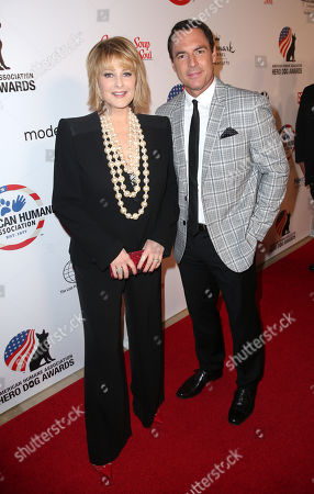 """Cristina Ferrare, left, and Mark Steines attend the American Humane Association's 4th Annual """"Hero Dog Awards"""" at the Beverly Hilton Hotel, in Beverly Hills, Calif"""