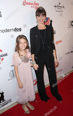 Victoria Stilwell, right, and guest attend the American Humane Association's 4th Annual Hero Dog Awards at the Beverly Hilton Hotel, in Beverly Hills, Calif