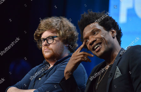 """Zack Pearlman, left, and Seaton Smith speak on stage during the """"Mulaney"""" panel at the The FOX 2014 Summer TCA held at the Beverly Hilton Hotel, in Beverly Hills, Calif"""