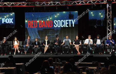 """Astro, seated from left, Ciara Bravo, Nolan Sotillo, Griffin Gluck, Zoe Levin, Charlie Rowe, Wilson Cruz, Rebecca Rittenhouse, Dave Annable, Octavia Spencer and Writer/Executive Producer Margaret Nagle speak on stage during the """"Red Band Society"""" panel at the The FOX 2014 Summer TCA held at the Beverly Hilton Hotel, in Beverly Hills, Calif"""