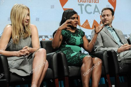 From left, Elizabeth Meriwether, Mindy Kaling, and Dan Goor appear onstage during the â?oeBehind The Laughsâ?? panel at the The FOX 2014 Summer TCA held at the Beverly Hilton Hotel, in Beverly Hills, Calif