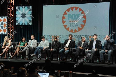 From left, Elizabeth Meriwether, Mindy Kaling, Dan Goor, Michael Schur, Will Forte, Al Jean, Richard Appel, Steve Callaghan, and Loren Bouchard onstage during the Behind The Laughs panel at the The FOX 2014 Summer TCA held at the Beverly Hilton Hotel, in Beverly Hills, Calif