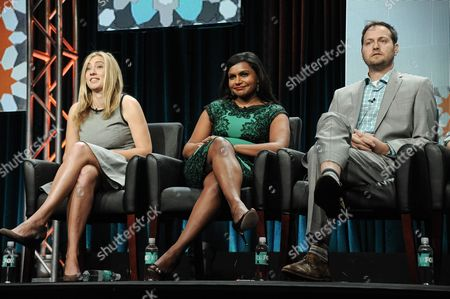 From left, Elizabeth Meriwether, Mindy Kaling, and Dan Goor appear onstage during the Behind The Laughs panel at the The FOX 2014 Summer TCA held at the Beverly Hilton Hotel, in Beverly Hills, Calif