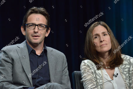 """Executive Producers Dan Futterman, left, and Carolyn Bernstein speak on stage during the """"Gracepoint"""" panel at the The FOX 2014 Summer TCA held at the Beverly Hilton Hotel, in Beverly Hills, Calif"""