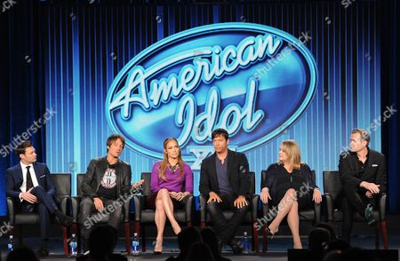 "From left, host Ryan Seacrest, judges Keith Urban, Jennifer Lopez and Harry Connick, Jr. and executive producers Trish Kinane and Per Blankens participate in FOX's ""American Idol XIII"" panel at the FOX Winter TCA Press Tour, on at the Langham Huntington, in Pasadena, Calif"