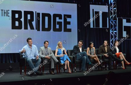 Stock Image of From left, Executive Producer Elwood Reid, Demian Bichir, Diane Kruger, Matthew Lilard, Emily Rios, Thomas M. Wright and Franka Potente speak on stage during the The Bridge panel at the The FX 2014 Summer TCA held at the Beverly Hilton Hotel, in Beverly Hills, Calif