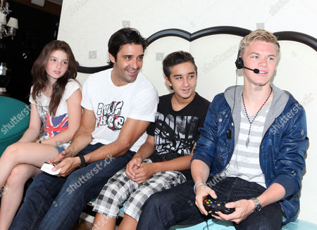 Kenton Duty, right, Gilles Marini, third from right, son Georges Marini, second from left, and niece Marjorie visit the Xbox 360 and Children's Miracle Network Gaming and Giving for Good (G3) Miracle Lounge on in West Hollywood, Calif