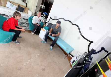 Stock Picture of Rick Malambri, right, and CHOC patient Kyle Gerberding, 14, play games at the Xbox 360 and Children's Miracle Network Gaming and Giving for Good (G3) Miracle Lounge on in West Hollywood, Calif
