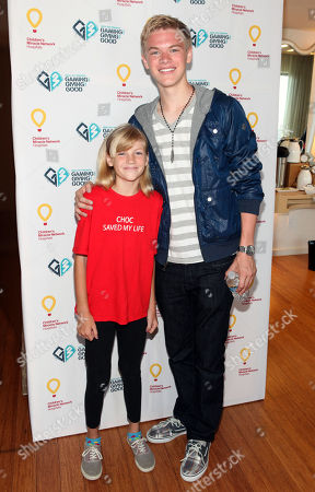 Kenton Duty, right, poses with CHOC patient Katie Gerberding, 10, at the Xbox 360 and Children's Miracle Network Gaming and Giving for Good (G3) Miracle Lounge on in West Hollywood, Calif