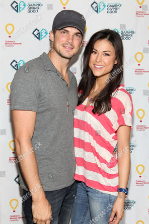 Rick Malambri, left, and Lisa Malambri pose for a photo at the Xbox 360 and Children's Miracle Network Gaming and Giving for Good (G3) Miracle Lounge on in West Hollywood, Calif