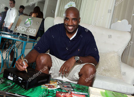 Ephraim Salaam signs an Xbox at the Xbox 360 and Children's Miracle Network Gaming and Giving for Good (G3) Miracle Lounge on in West Hollywood, Calif