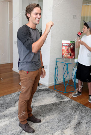 Stock Photo of Alex Heartman plays a game at the Xbox 360 and Children's Miracle Network Gaming and Giving for Good (G3) Miracle Lounge on in West Hollywood, Calif