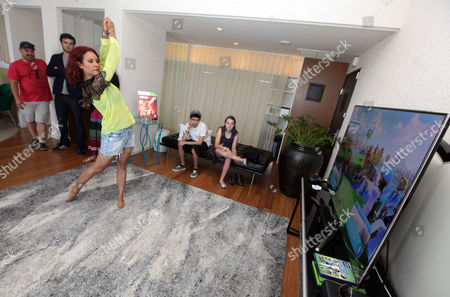Nikki Chu plays a game at the Xbox 360 and Children's Miracle Network Gaming and Giving for Good (G3) Miracle Lounge on in West Hollywood, Calif