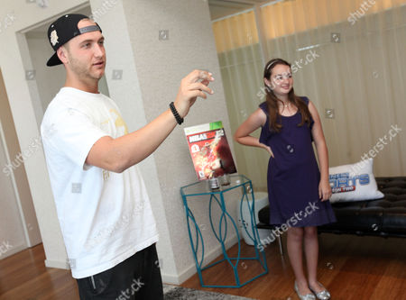 Nick Hogan, left, and Eileen Garrido, 13, play a game at the Xbox 360 and Children's Miracle Network Gaming and Giving for Good (G3) Miracle Lounge on in West Hollywood, Calif