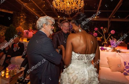 George Lucas, Robin Williams, his wife Susan Schneider and Mellody Hobson during the George Lucas and Mellody Hobson's wedding reception at Promontory Point on in Chicago