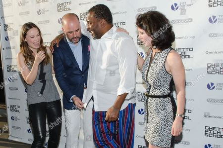 Olivia Wilde, Joe Hall, Lee Daniels, and Katherine Oliver share a laugh at the Ghetto Film School 10th Annual Spring benefit at The Standard Biergarten on in New York
