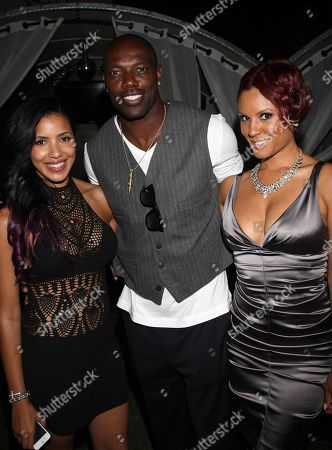 Stock Image of L-R) Julissa Bermudez, Terrell Owens and Nikki Chu pose at Girlfriend Confidential LA Premiere Episode Party at Xen Lounge, in Studio City, California