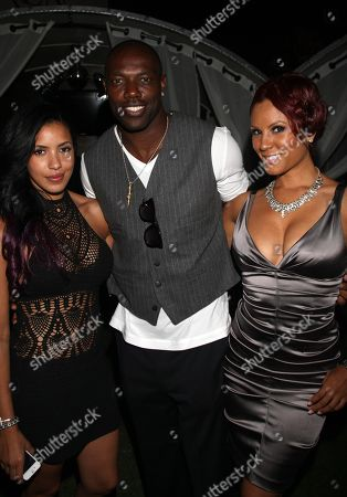 L-R) Julissa Bermudez, Terrell Owens and Nikki Chu pose at Girlfriend Confidential LA Premiere Episode Party at Xen Lounge, in Studio City, California