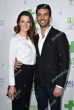 Stock Picture of Justin Baldoni, right, and Emily Foxler arrive at the Global Green 13th annual pre-Oscar party at Mr. C Beverly Hills on in Los Angeles