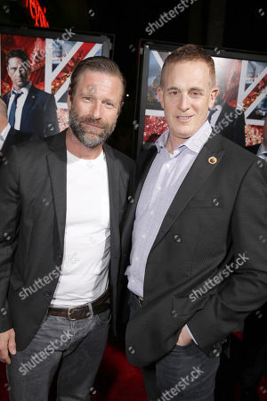 Aaron Eckhart and Peter Schlessel, Chief Executive Officer, Focus Features, seen at Grammercy Pictures Present the Los Angeles Premiere of 'London Has Fallen' at ArcLight Hollywood, in Hollywood, CA