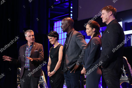 """Major Nelson, Director of Programming for the Microsoft gaming network Xbox Live, Kiki Wolfkill, Executive Producer at 343 Industries Studio, and """"Halo: Nightfall"""" cast Mike Coulter, Christina Chong and Steve Waddington, from left, speak at HaloFest at the Avalon Theatre in Los Angeles on"""